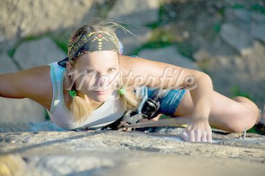Image of blonde lady climbing on the rock Stock Photo - Royalty-Free, Artist: pressmaster, Code: 400-04146115