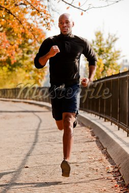 An African American jogging in a park in the morning Stock Photo - Royalty-Free, Artist: Leaf, Code: 400-04149629