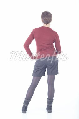 Cute young adult caucasian woman with short hair in a red top, black shorts and stockings on a white background in various poses, with various facial expressions. Not Isolated Stock Photo - Royalty-Free, Artist: Forgiss, Code: 400-04160465
