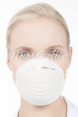 Close-up of a young woman with protecting mask Stock Photo - Royalty-Free, Artist: stefanolunardi, Code: 400-04160766