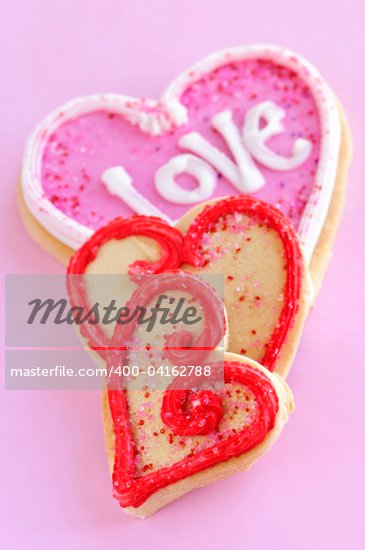 Homemade baked shortbread Valentine cookies with icing on pink background Stock Photo - Royalty-Free, Artist: Elenathewise, Code: 400-04162788