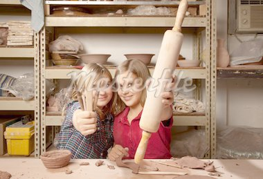 Young girls holding craft tools in clay studio Stock Photo - Royalty-Free, Artist: creatista, Code: 400-04168768