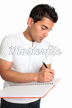 A man or student writes in a notebook Stock Photo - Royalty-Free, Artist: lovleah, Code: 400-04172166