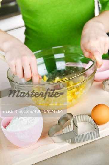 Mixing ingredients for baking cookies in glass bowl Stock Photo - Royalty-Free, Artist: Elenathewise, Code: 400-04174564