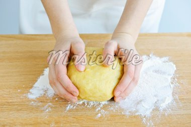 Hands kneading ball of dough with flour on cutting board Stock Photo - Royalty-Free, Artist: Elenathewise, Code: 400-04174569