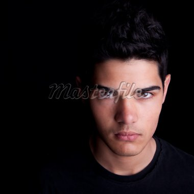 Portrait of a handsome young man on black background. Studio shot. Stock Photo - Royalty-Free, Artist: ajn, Code: 400-04177874
