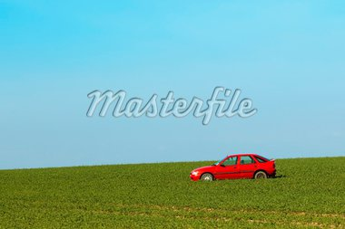 a bright red abandoned car in a field on a hillside under a clear blue sky Stock Photo - Royalty-Free, Artist: emjaysmith, Code: 400-04182199
