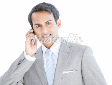 Happy businessman taking a phone call in  the office Stock Photo - Royalty-Free, Artist: 4774344sean, Code: 400-04185766