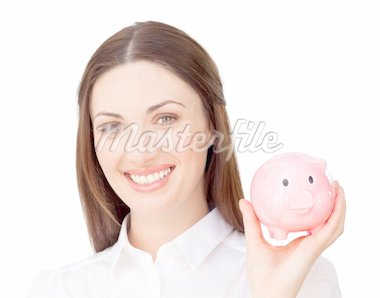 Smiling businesswoman saving money in a piggybank in the office Stock Photo - Royalty-Free, Artist: 4774344sean, Code: 400-04187474