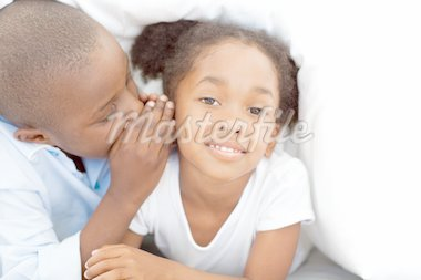 Adorable little boy whispering something to his sister under the cover Stock Photo - Royalty-Free, Artist: 4774344sean, Code: 400-04192414