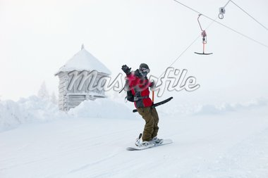 Snowboarder rises up the mountain on sky-lift. Ukraine, Dragobrat. Stock Photo - Royalty-Free, Artist: photobac, Code: 400-04204405