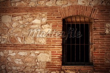 An old stone wall and a window with bars Stock Photo - Royalty-Free, Artist: macniak, Code: 400-04213956