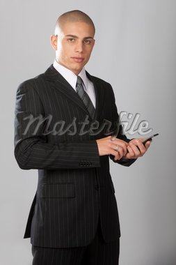 A young good looking businessman on a gray background. Stock Photo - Royalty-Free, Artist: Daniel_Wiedemann, Code: 400-04223061
