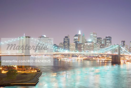 New York City Brooklyn Bridge and Manhattan skyline with skyscrapers over Hudson River illuminated with lights at dusk after sunset. Stock Photo - Royalty-Free, Artist: rabbit75_cre, Code: 400-04240625