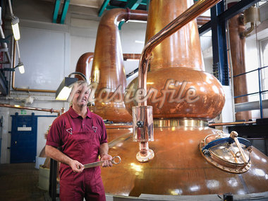 Worker with stills in distillery Stock Photo - Premium Royalty-Freenull, Code: 649-04248747