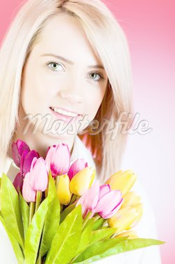 Young girl with tulips against colourful background Stock Photo - Royalty-Free, Artist: ElnurCrestock                 , Code: 400-04273161
