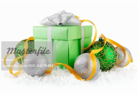 gift in snow with bow and  green balls isolated on white background Stock Photo - Royalty-Free, Artist: yasonya                       , Code: 400-04278482