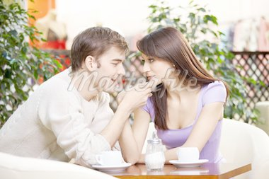 Young man kisses a hand to the beautiful girl on cafe Stock Photo - Royalty-Free, Artist: Deklofenak                    , Code: 400-04278861