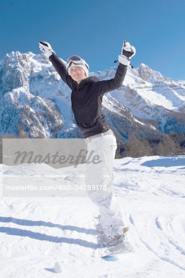 Beautiful girl on snowboard with both hands rised Stock Photo - Royalty-Free, Artist: dash                          , Code: 400-04289178