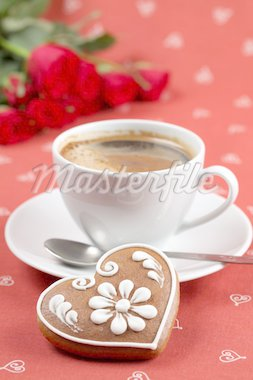 Gingerbread heart with coffee and red roses on red background. Shallow dof Stock Photo - Royalty-Free, Artist: ingridhs                      , Code: 400-04291992
