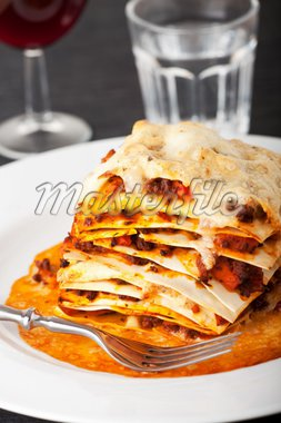 closeup of lasagna with red wine Stock Photo - Royalty-Free, Artist: bernjuer                      , Code: 400-04303616
