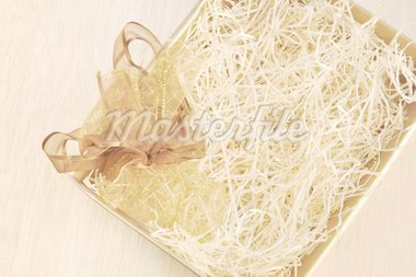 Open gift box and bow - filled with packing bast Stock Photo - Royalty-Free, Artist: brozova                       , Code: 400-04306385