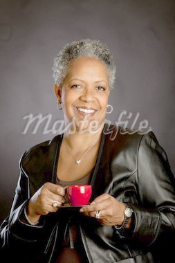 African American woman drinking coffee Stock Photo - Royalty-Free, Artist: joeglab                       , Code: 400-04318263