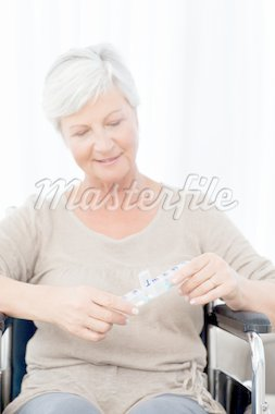 Senior in wheelchair with pills Stock Photo - Royalty-Free, Artist: 4774344sean                   , Code: 400-04318731