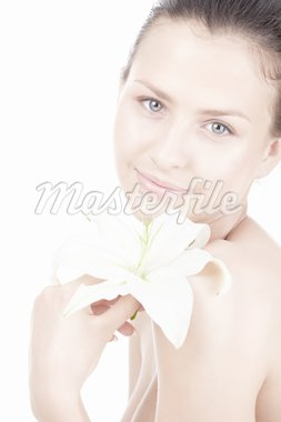 Beautiful girl with a lily on a white background Stock Photo - Royalty-Free, Artist: Deklofenak                    , Code: 400-04320877