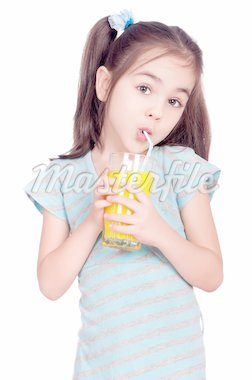 Portrait of happy little girl drinking orange juice Stock Photo - Royalty-Free, Artist: fotostok_pdv                  , Code: 400-04325030