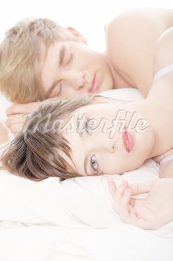 Beautiful young couple sleeping in bed. Stock Photo - Royalty-Free, Artist: BDS                           , Code: 400-04334865