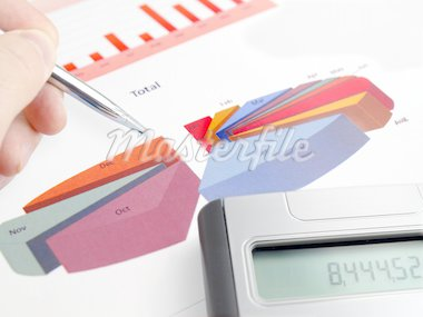 Male hand with pen on pie investment chart with calculator Stock Photo - Royalty-Free, Artist: NAN104                        , Code: 400-04344361
