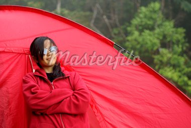 Asian malay teen girl standing beside red tent outdoors Stock Photo - Royalty-Free, Artist: palangsi                      , Code: 400-04346509