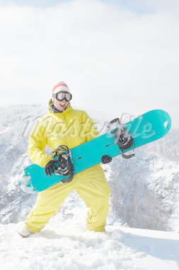 View of sportsman with snowboard standing in the forest Stock Photo - Royalty-Free, Artist: pressmaster                   , Code: 400-04351565