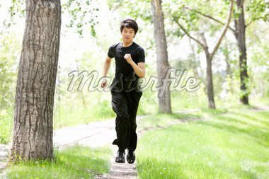 Portrait of handsome man running against blur background Stock Photo - Royalty-Free, Artist: Leaf                          , Code: 400-04354422