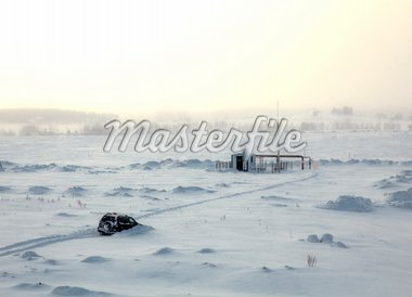 car stuck in snow near the research station Stock Photo - Royalty-Free, Artist: vicnt                         , Code: 400-04355537