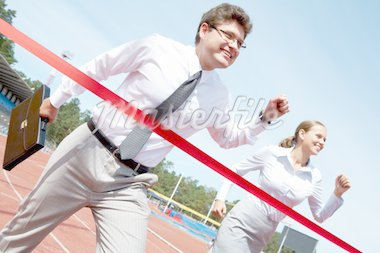 Photo of successful businessman crossing finish line during race Stock Photo - Royalty-Free, Artist: pressmaster                   , Code: 400-04364079