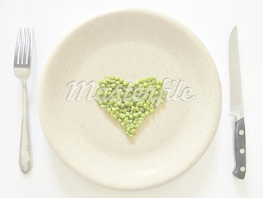 Heart shaped peas on a plate with cutlery. Stock Photo - Royalty-Free, Artist: creashot                      , Code: 400-04366641