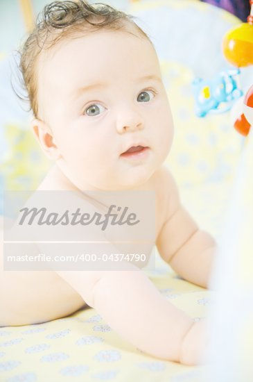 Beautiful cute baby boy is lying in a bed. Stock Photo - Royalty-Free, Artist: macsim                        , Code: 400-04374790