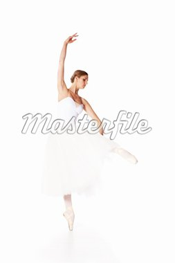 a beautiful ballerina in studio - over blue and violet bachkround Stock Photo - Royalty-Free, Artist: msdnv                         , Code: 400-04376134
