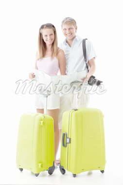 Attractive young couple with suitcases and map isolated Stock Photo - Royalty-Free, Artist: Deklofenak                    , Code: 400-04377657
