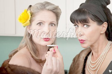 Two retro-styled Caucasian women in mink coats smoke weed Stock Photo - Royalty-Free, Artist: creatista                     , Code: 400-04380617