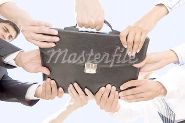 Below angle of people hands holding black leather briefcase simultaneously Stock Photo - Royalty-Free, Artist: pressmaster                   , Code: 400-04380969
