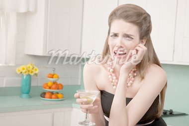 Caucasian woman with a martini in her kitchen sobs Stock Photo - Royalty-Free, Artist: creatista                     , Code: 400-04381944