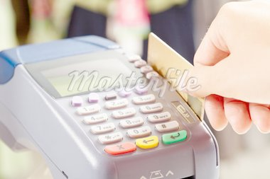 Close-up of payment machine buttons with human hand holding plastic card near by Stock Photo - Royalty-Free, Artist: pressmaster                   , Code: 400-04384202