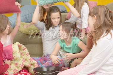 Little girl about to get whacked with a pillow at a sleepover Stock Photo - Royalty-Free, Artist: creatista                     , Code: 400-04385870