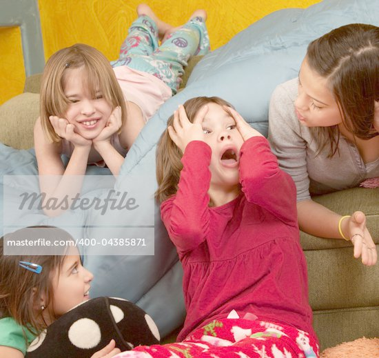 Surprised little girl with hands on head with friends at a sleepover Stock Photo - Royalty-Free, Artist: creatista                     , Code: 400-04385871