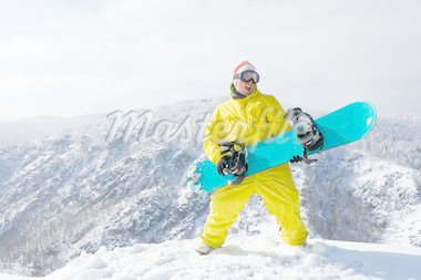Portrait of excited sportsman with snowboard standing on top of mount Stock Photo - Royalty-Free, Artist: pressmaster                   , Code: 400-04387416