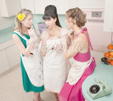 Three retro-styled women smoking cigarettes in a kitchen Stock Photo - Royalty-Free, Artist: creatista                     , Code: 400-04391466