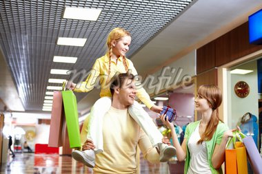 Image of family with paperbags and giftbox in the mall Stock Photo - Royalty-Free, Artist: pressmaster                   , Code: 400-04395477